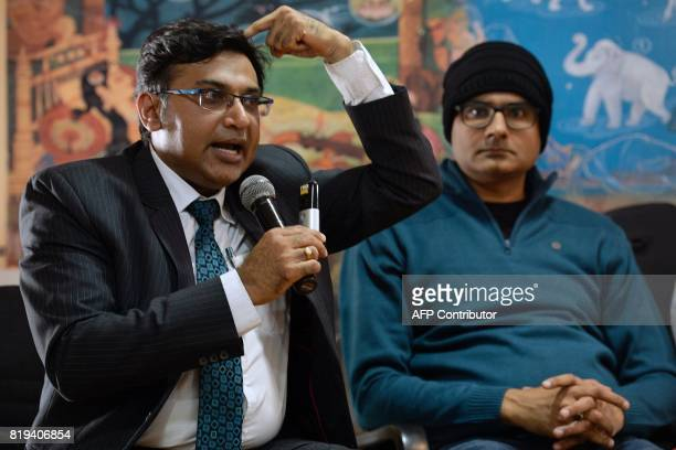 In this photograph taken on July 18 Dr Sharan Srinivasan Senior Consultant Neurosurgeon gestures while he speaks as his patient Abhishek Prasad...