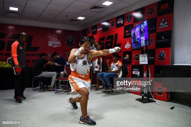 In this photograph taken on July 21 boxer Lalnunfeli with the Maratha Yoddhas team prepares before her fight during a Super Boxing League event in...