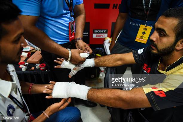 In this photograph taken on July 21 boxer Sandeep Dhull with the Bahubali Boxers team prepares before a fight during a Super Boxing League event in...