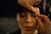 In this photograph taken on July 22 a model has her makeup done ahead of the show by Indian designer Rahul Mishra during the India Couture Week in...