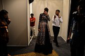 In this photograph taken on July 22 a model waits ahead of the show by Indian designer Rahul Mishra during the India Couture Week in New Delhi / AFP...
