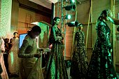 In this photograph taken on July 22 models wait at the backstage during the show by Indian designer Rahul Mishra at the India Couture Week in New...