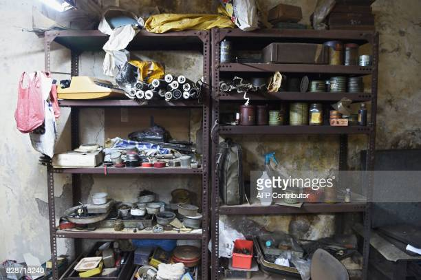 In this photograph taken on July 26 a rack is seen at the repair shop of typewriter mechanic Anand Savarkar in Mumbai The unmistakable chatter of...