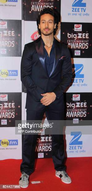 In this photograph taken on July 29 Indian Bollywood actor Tiger Shroff attends the BIG ZEE Entertainment Awards 2017 ceremony in Mumbai / AFP PHOTO...