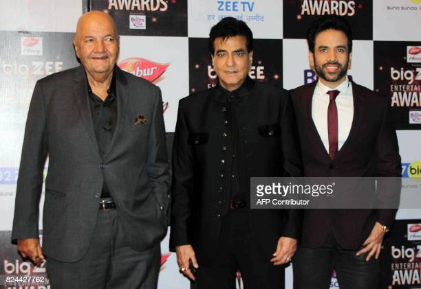 In this photograph taken on July 29 Indian Bollywood actors Prem Chopra Jitendra and Tussar Kapoor attend the BIG ZEE Entertainment Awards 2017...
