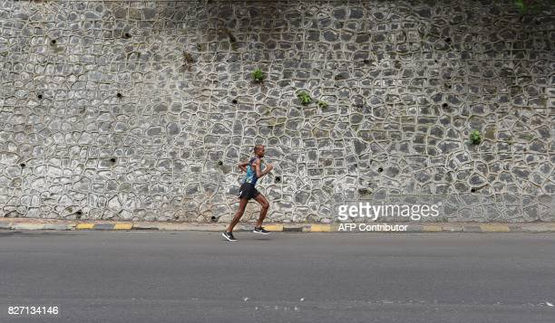 In this photograph taken on July 30 2017 Indian runner Samir Singh runs in Mumbai Tormented by blisters illness and injuries Indian ultramarathoner...