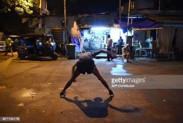 In this photograph taken on July 30 2017 Indian runner Samir Singh stretches before the start of his run in the early morning in Mumbai Tormented by...