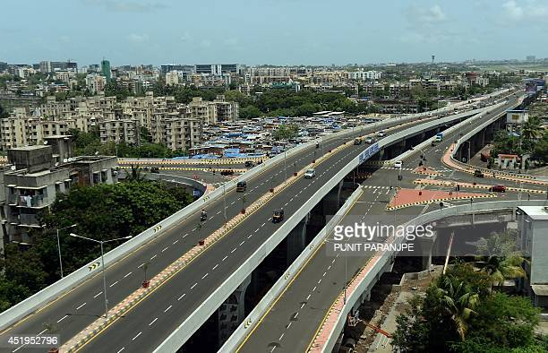 In this photograph taken on July 6 2014 commuters travel along the newly inaugurated freeway between Santacruz and Ghatkopar in Mumbai India's new...