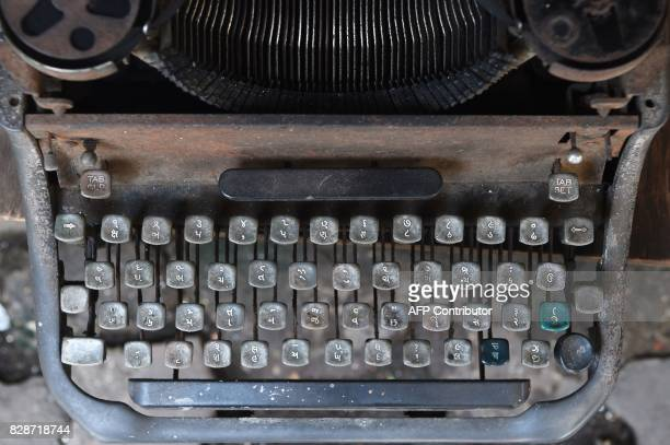 In this photograph taken on July 6 a defunct typewriter is displayed to attract customers at a roadside typing shop in Mumbai The unmistakable...