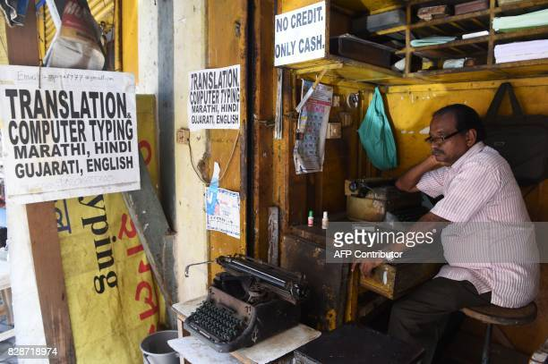 In this photograph taken on July 6 a typist waits for customers at his roadside typing shop in Mumbai The unmistakable chatter of typewriters outside...