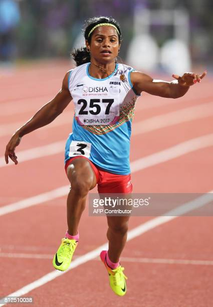 In this photograph taken on July 6 Indian athlete Dutee Chand takes part in the womens 100m heat at the 22nd Asian Athletics Championships at Kalinga...