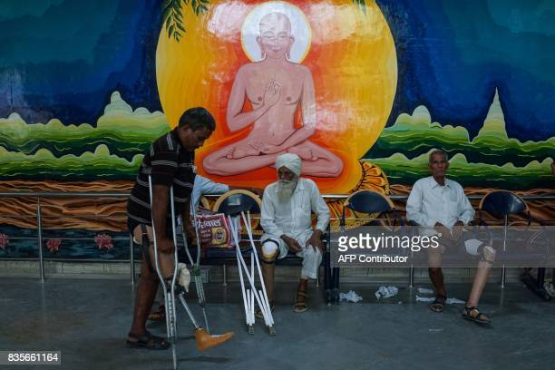 In this photograph taken on June 13 an Indian man practices walking with a rubberbased prosthetic leg at the Bhagwan Mahaveer Viklang Sahayata Samiti...