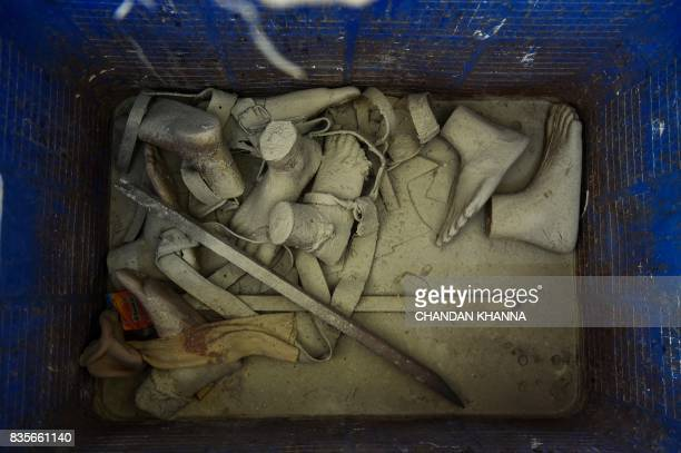 In this photograph taken on June 13 old prosthetic legs and belts are seen in a dustbin at the Bhagwan Mahaveer Viklang Sahayata Samiti nonprofit...