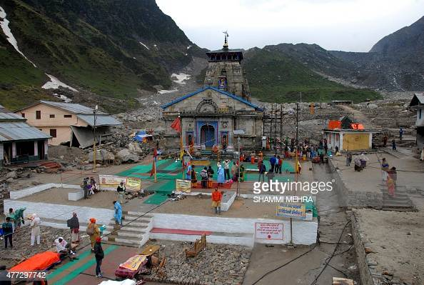 In this photograph taken on June 14 Indian devotees gather at the partially restored Kedarnath Temple in the northern state of Uttarakhand nearly two...