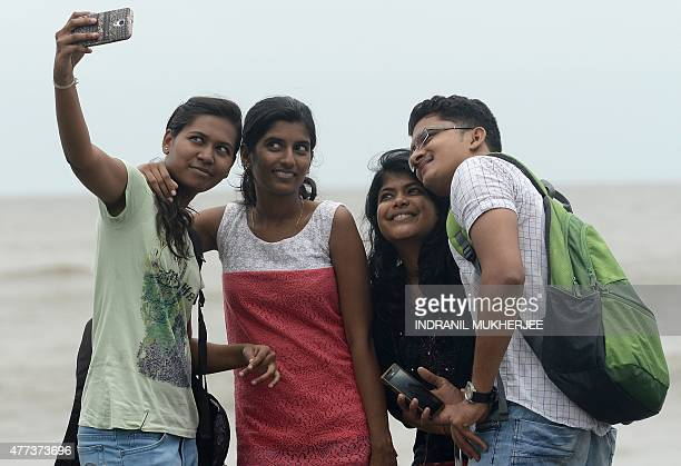 In this photograph taken on June 15 young Indian students take a 'selfie' on Marine Drive promenade in Mumbai Selfies have become a global phenomenon...