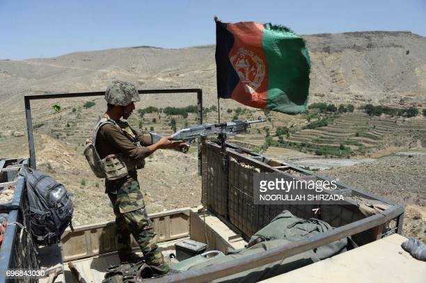 In this photograph taken on June 16 2017 Afghan security force take positions during an operation against Islamic State militants in the Tora Bora...