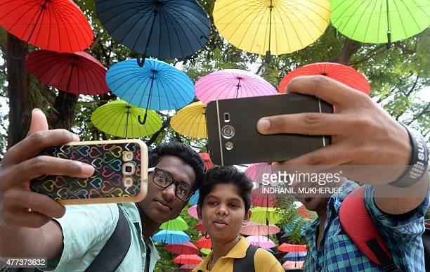 In this photograph taken on June 16 Indian students click a selfie at a designated 'selfie point' in Mumbai Selfies have become a global phenomenon...