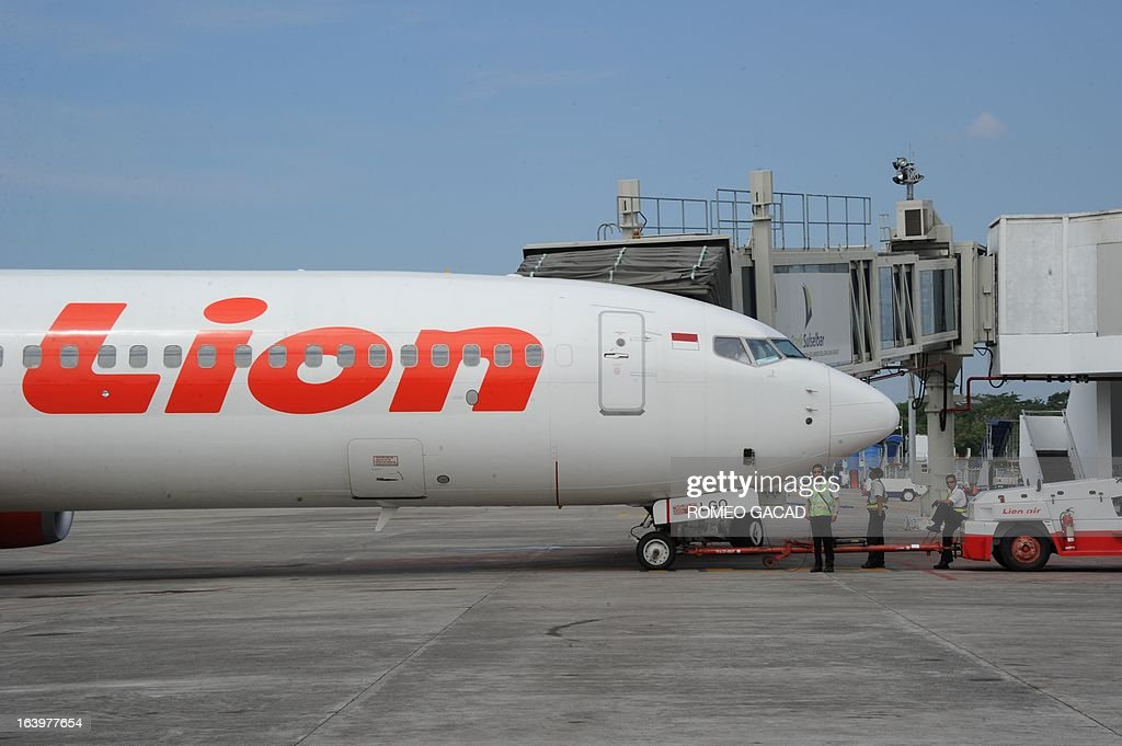 In this photograph taken on June 21 an Indonesian Lion Air Boeing 737 aircraft is parked at Makassar airport terminal on Sulawesi island Lion Air a...