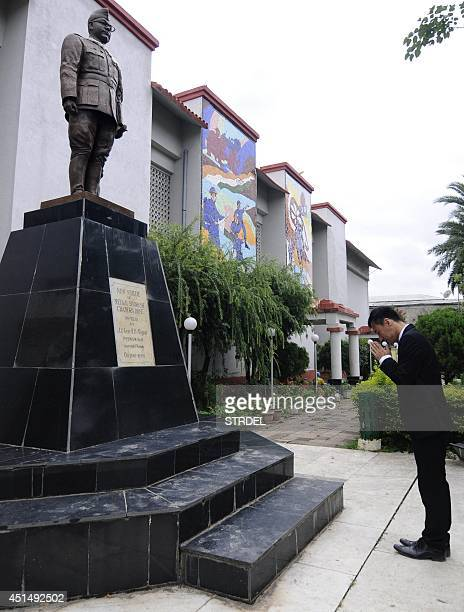 In this photograph taken on June 28 Japanese film director Junichi Kajioka pays his respects in front of a of Indian freedom fighter Subhash Chandra...
