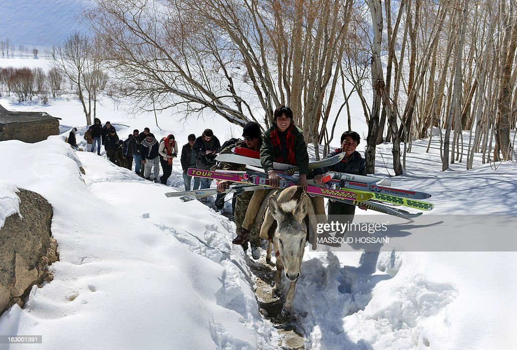 In this photograph taken on March 1, 2013, young Afghan Hazara men transport skis on a donkey in the Shahidan Valley of Bamiyan province. Seventeen Afghan ski challengers and twelve foreigners participated in the third annual Afghan Ski Challenge in Bamiyan during which the Afghan Hazara men won the first three positions. AFP PHOTO / Massoud HOSSAINI