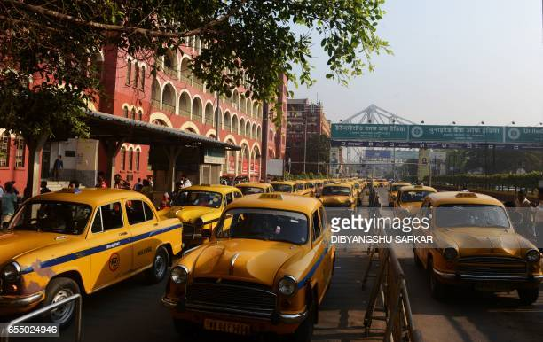 In this photograph taken on March 16 Hindustan Motors Ambassador taxis wait in a prepaid queue outside Howrah Station in Kolkata India's Hindustan...