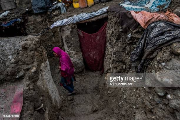 TOPSHOT In this photograph taken on March 22 Afghan resident Fareeza who is unsure of her age walks through the home she shares with relatives of the...