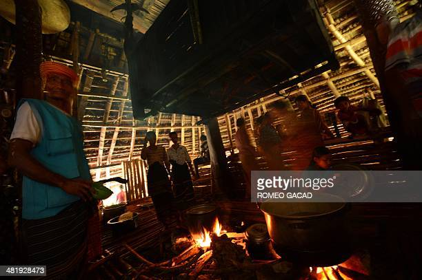 In this photograph taken on March 22 Sumbanese tribesmen and women prepare food inside their traditional home in Ratenggaro village located in...