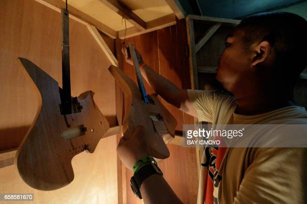 In this photograph taken on March 27 2017 guitar workshop owner Dana Suhana stores basecoatpainted guitar bodies inside a high temperature chamber at...