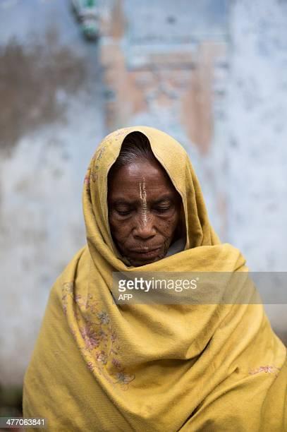 In this photograph taken on March 5 eighty year old Indian widow Mayarani Dasi poses at the Meerasahabhagini Ashram in Vrindavan some 135 kilometres...