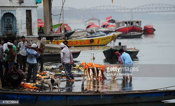 In this photograph taken on May 10 shows preparations for a funeral ceremony at the country's largest cremation site Manikarnika Ghat on the River...