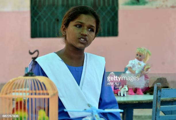 In this photograph taken on May 11 eleven year old former Pakistani child labourer Shumaila Bibi speaks to AFP during an interview at a school on the...