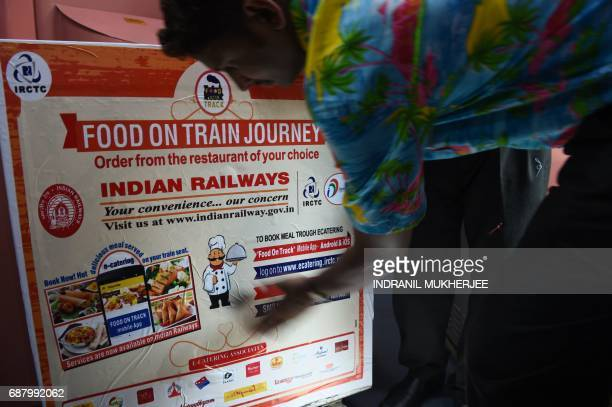 In this photograph taken on May 22 Indian staff prepare a food trolley onboard the Tejas Express luxury train during its first journey between Mumbai...