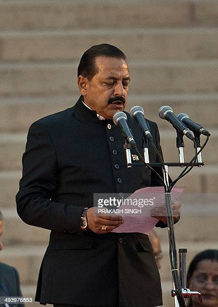 In this photograph taken on May 26 Bharatiya Janata Party MP Jitendra Singh takes the oath of office during a swearingin ceremony for new Indian...