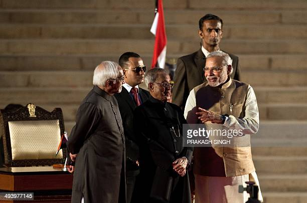 In this photograph taken on May 26 newly swornin Indian Prime Minister Narendra Modi gestures as he talks with President Pranab Mukherjee and Vice...