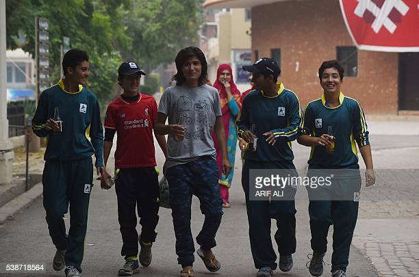 In this photograph taken on May 3 Pakistani national cricket and football player Diana Baig shares a light moment with her colleagues at a football...