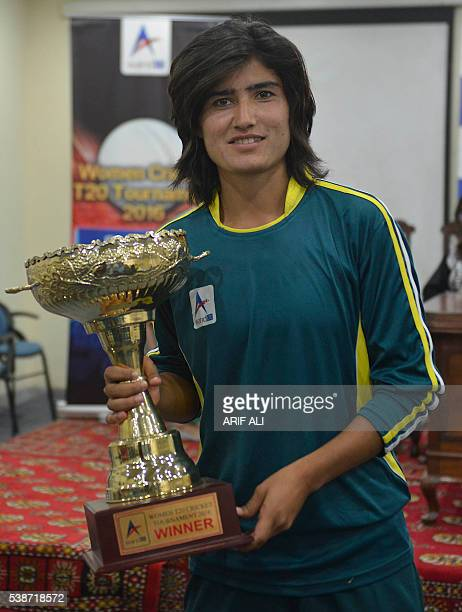 In this photograph taken on May 3 Pakistani national cricket and football player Diana Baig poses with a cricket trophy in Lahore Baig is no stranger...