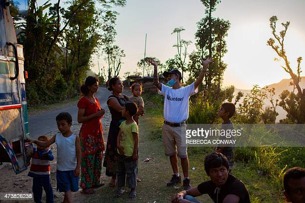 In this photograph taken on May 4 Nepalese earthquake survivors speak with a volunteer from Nepali NGO the Earthquake Relief Collection Centre at the...