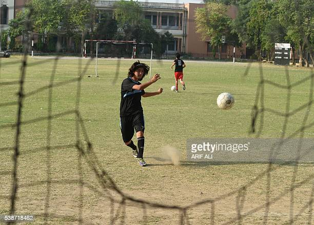 In this photograph taken on May 4 Pakistani national cricket and football player Diana Baig takes part in a football training session at a ground in...