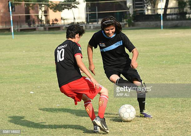 In this photograph taken on May 4 Pakistani national cricket and football player Diana Baigtakes part in a football training session at a ground in...