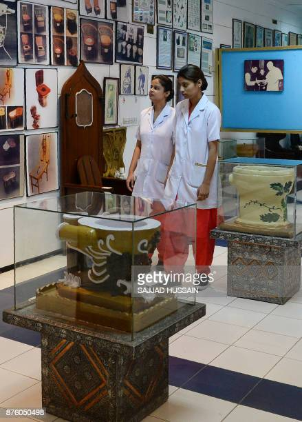 In this photograph taken on November 15 nursing students walk through the Sulabh International Museum of Toilets in New Delhi A throne with a builtin...