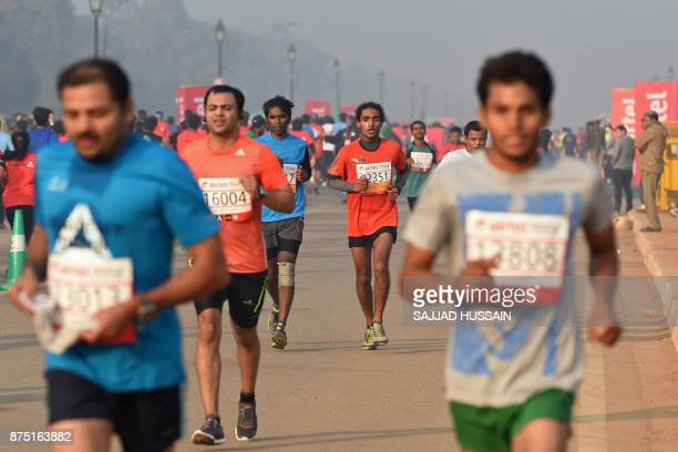 In this photograph taken on November 23 participants make their way along Rajpath during the Delhi Half Marathon in New Delhi A court in India's...