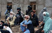 In this photograph taken on November 3 Afghan Taliban fighters look on as they listen to Mullah Mohammad Rasool Akhund the newly appointed leader of...