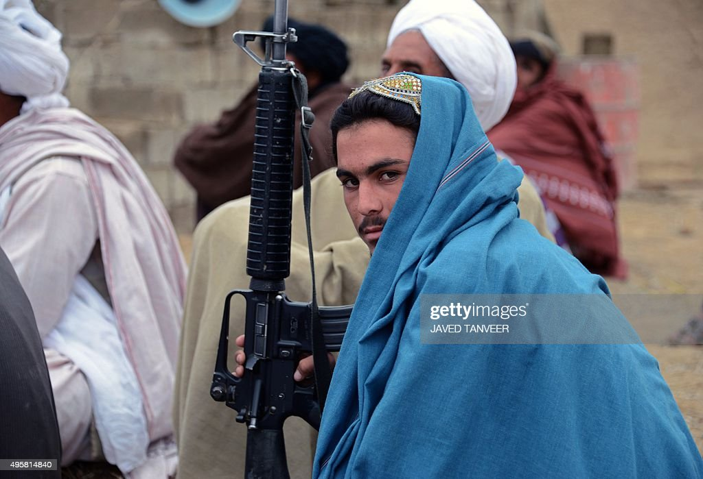 In this photograph taken on November 3 an Afghan Taliban fighter looks on as he listens to Mullah Mohammad Rasool Akhund the newly appointed leader...