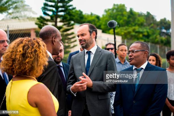 In this photograph taken on November 4 French Prime Minister Edouard Phillipe speaks with officials including Mayor Didier Laguerre Senator Catherine...