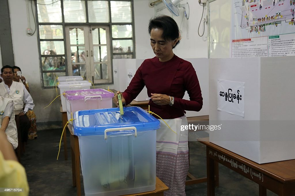 In this photograph taken on November 8 Myanmar opposition leader Aung San Suu Kyi and head of the National League for Democracy party casts her...