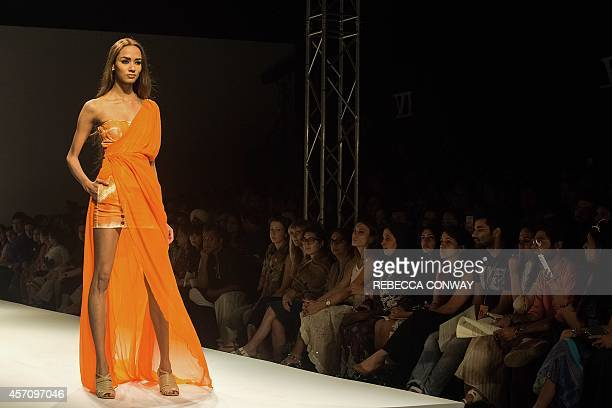 In this photograph taken on October 11 2014 a model showcases a creation by Indian designer Raakesh Agarvwal during the Wills Lifestyle India Fashion...