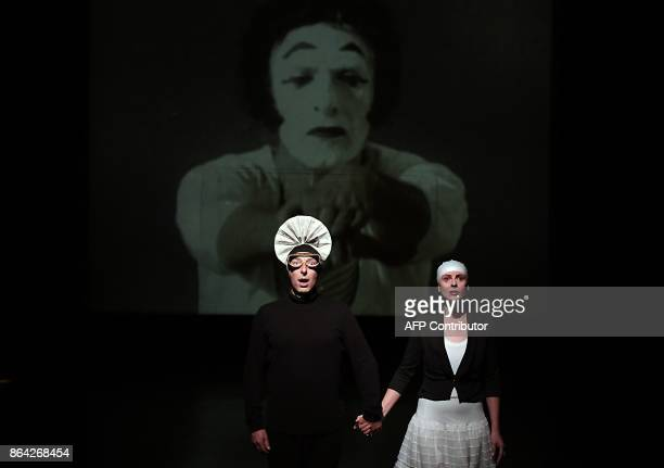 In this photograph taken on October 17 Aurelia Marceau daughter of the famous mime Marcel Marceau and Olivier Copin take part in a scene in a...