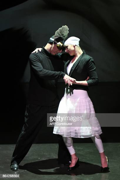 In this photograph taken on October 17 Aurelia Marceau daughter of the famous mime Marcel Marceau and actor Olivier Copin take part in a scene in a...