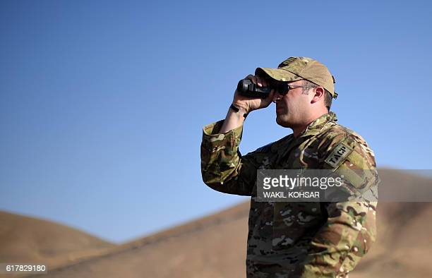 In this photograph taken on October 18 a NATOled Joint Terminal Attack Controller Tech official from the US military watches an airstrike training...