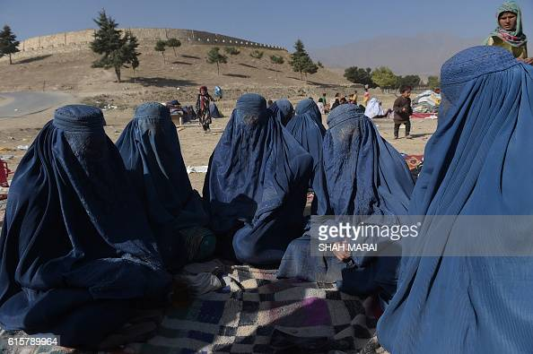TOPSHOT In this photograph taken on October 19 Afghan women who were displaced by Kunduz fighting between Afghan forces and Taliban insurgents gather...